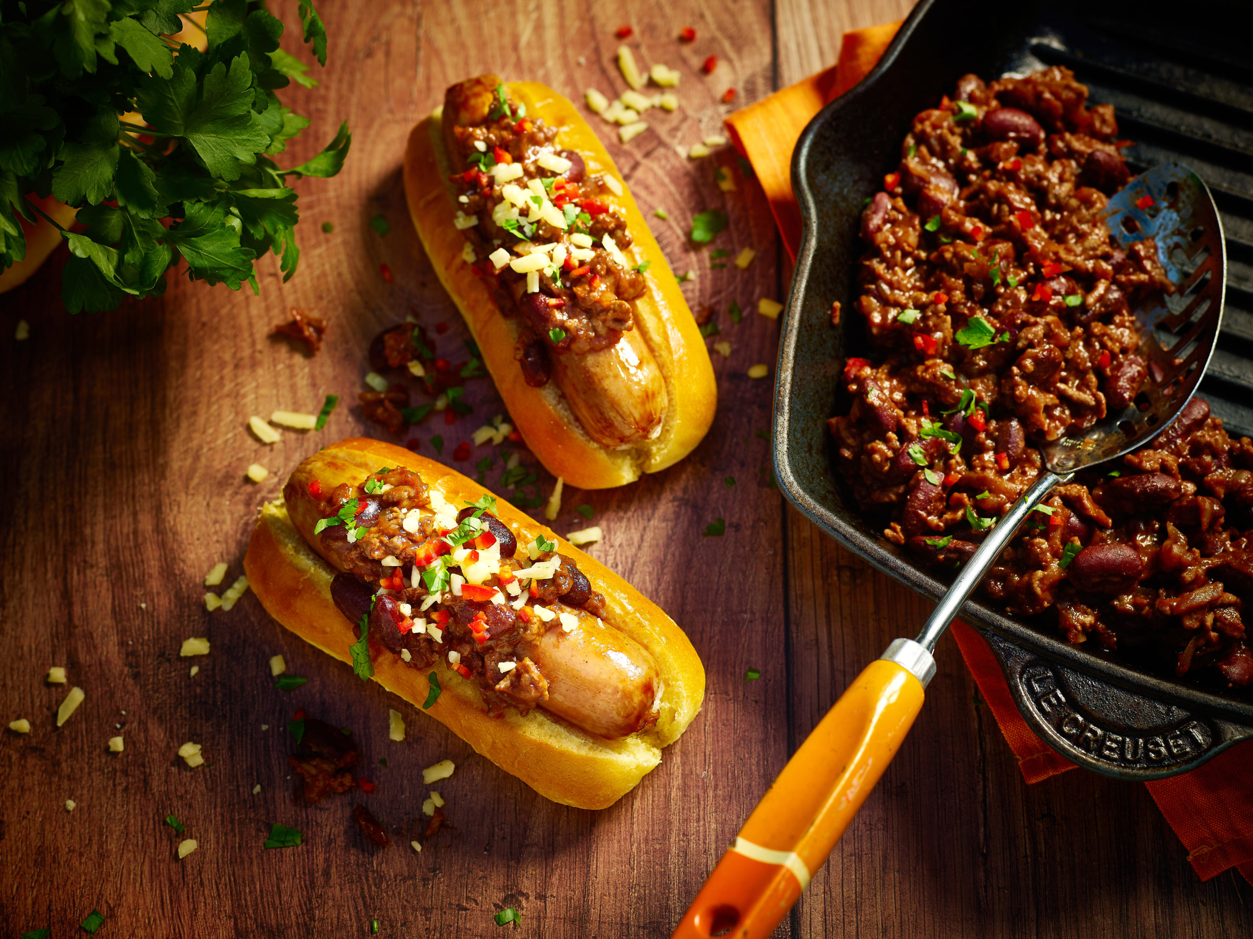 St Pierre Brioche Hot Dog Rolls on a table with chilli