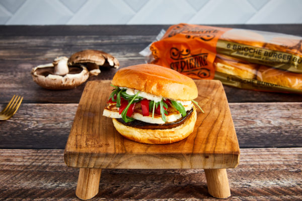 Galentine's Day ideas: a photo of a halloumi burger on a wooden board