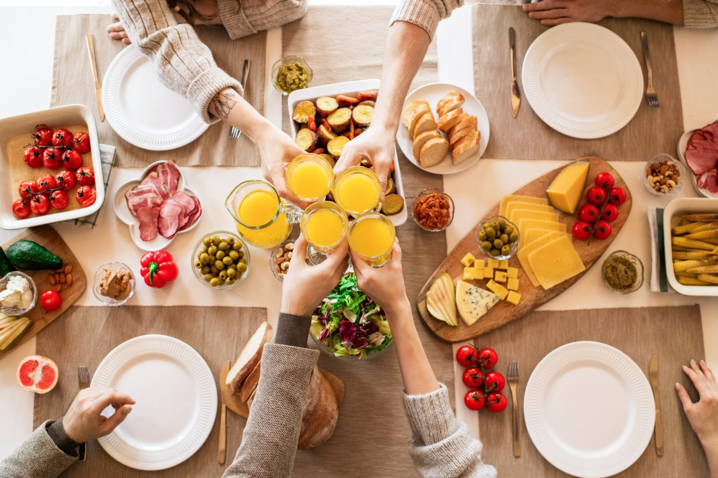 Overhead photo of people enjoying a Mother's Day spread