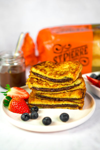 Easter recipe ideas: a photo of a Nutella-filled French toast recipe on a plate with strawberries and blueberries